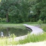 The pond, with the curving raised walkway